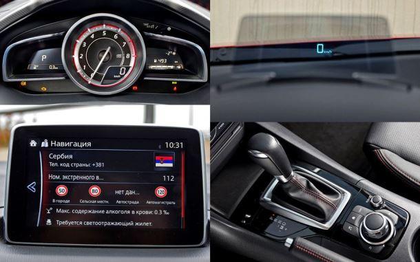 Фото: Салон Мазды 3 2014: панель приборов, head-up дисплей, сенсорный экран, коробка передач