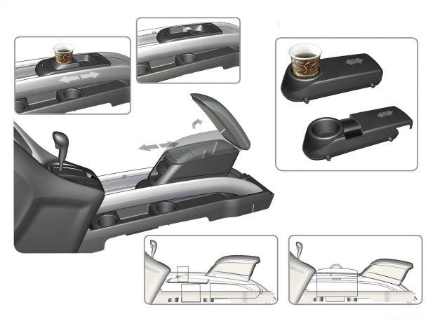 Фото: Использование ёмкости ежду передними сидениями. Три в одном: два ящичка и подстаканник